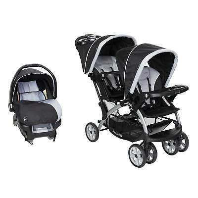 sit n stand tandem stroller and infant